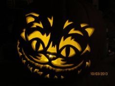Hand caved cheshire cat carved pumpkin