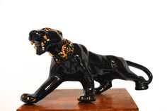 Large, #vintage Mid-century modern art deco black #panther/jaguar with gold highlights on claws, teeth, eyes, and collar. Recognizable piece of #MCM