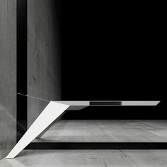 Bulgarian studio Bozhinovskidesign have created a cantilevered desk suspended from the wall by steel cables.