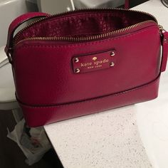 Kate Spade purse Maroon/Berry colored Kate Spade purse. Can be worn on shoulder or as a cross body. One small imperfection on the bottom corner but in excellent shape other than that. kate spade Bags Crossbody Bags