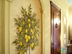 Realistic lemon trees in large flower pots painted on the walls of a private home.