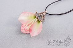 Pendant with flower petals from the cold porcelain on leather cord
