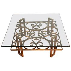 Gilded Wrought Iron Square Coffee Table with Scroll Motif Glass Top | From a unique collection of antique and modern coffee and cocktail tables at https://www.1stdibs.com/furniture/tables/coffee-tables-cocktail-tables/