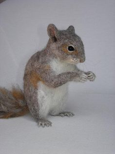 Needle Felted Squirrel by Tamara111, via Flickr. As realistic as some of the squirrels shown Are, they fall short when it comes to the tail. The tails need to be flatter and also whispier on the outside edges.