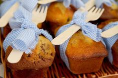 wooden cutlery tied around bread with ripped pieces of gingham fabric