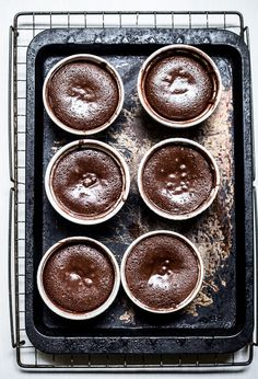 Salted Caramel Filled Molten Chocolate Cakes | Top With Cinnamon  Share the Chocolate Love at http://www.facebook.com/ChocolateIsMyBFF