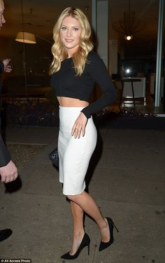 Blonde beauty: Canadian actress Katheryn Winnick looked gorgeous in a white pencil skirt and black cropped top as she entered the venue