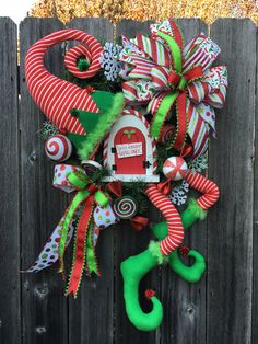 Excited to share this item from my #etsy shop: CHRISTMAS Elf Door Wreath #elf #elves #christmas #wreath #wreathattachment, #candyland #ornaments #ribbon #bow #elflegs #elfhat #elfset #elfdecor #christmasdecor #christmaswreath #limegreen #red #candycanesign #thenorthpole #santaclaus #etsy #etsyfinds #etsyshop #etsyseller #holidaydecor #google #holidaze #instagood #pin #tweet #instalike #christmaselfwreath #whimsicalchristmasdecor #wreathshop #wreathmaker #showstopper #whimsicalelf #santashelper Christmas Mesh Wreaths, Christmas Swags, Christmas Elf, Christmas Themes, Door Wreaths, Christmas Crafts, Christmas Decorations, Holiday Decorating, Elf Door