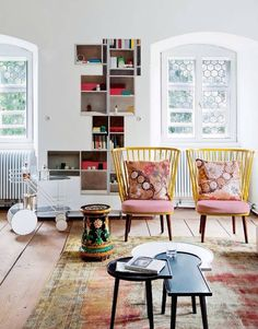 Yellow chairs, colorful pillows, bright windows