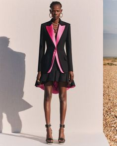 A single-breasted trompe l'oeil jacket in black wool silk with hibiscus pink duchess satin lapels. Worn over an asymmetrical ruffle hem… Big Fashion, Fashion 2020, Fashion News, Fashion Design, Hollywood Red Carpet, Matches Fashion, Fashion Seasons, Elegant Outfit, Looks Style
