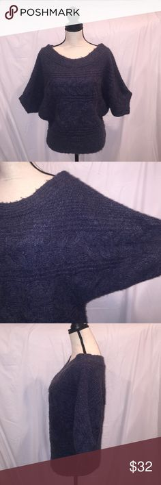 Free People Dolman Sleeve Cable Knit Sweater Free People Dolman Sleeve Cable Knit Sweater in navy with gray woven through.  This is a FP classic. A lot of detail in the knitting, scoop neckline (a few ideas are wear with a scoop tee or a button down blouse).  Wrap a scarf around it or wear those extra long necklaces. Very soft. Banded waistline. 69 acrylic/29 wool/1 spandex/1 FP other fiber. Has only been dry cleaned. Free People Sweaters Crew & Scoop Necks