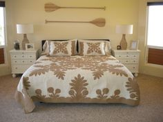 Hawaiian quilt and paddle headboard to match