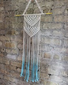 How to macrame this pretty dip-dyed wall hanging.