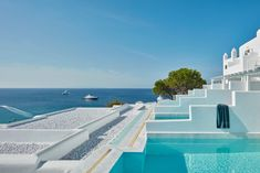 Perched on the rocky slopes of Mykonos, Greece and overlooking the Platis Gialos beach, the Myconian Ambassador Hotel was in serious need of a fresh update—one that would make all travelers' island dreams come true.