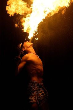 Fire eating - our friend does this, would be soo cool to have him do a display at our wedding.