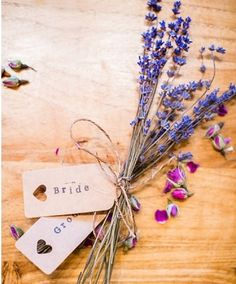 rustic vintage decoration or place card idea: lavender tied together with natural twine and sepia / kraft paper name tags.  | By Lisa Carpenter Photography