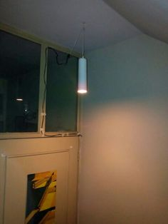 Made this hanging light from used water filter candel