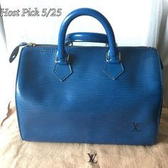 Louis Vuitton Epi Speedy 25 This beautiful bag is Louis Vuitton Classic Blue Epi Speedy 25. All four corners have normal wear, small scratches on exterior pocket side, some stain inside, interior pocket in good condition....all of these are in the photos so please check all photos carefully as they describe the condition of the bag. Overall in great condition! Feel free to ask any question. Louis Vuitton Bags Totes