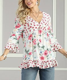 A floral print adds a pop of playful color to this tunic designed with ruffles at the hem for extra charm. Shipping note: This item is made to order. Allow extra time for your special find to ship.