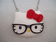 hello kitty necklace, i've never been a hello kitty fanatic but i like her w/ the nerd glasses. super cute