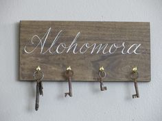 hand painted HARRY POTTER alohomora spell key rack holder sign house warming gift by BurnedOutHalos on Etsy https://www.etsy.com/listing/182774873/hand-painted-harry-potter-alohomora