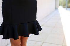 Detail of neoprene black dress