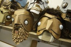 Card board masks by Kiel Johnson.