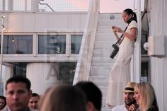 Angela Pham multitasking in all white (this was shot pre-Labor Day so don't even start).