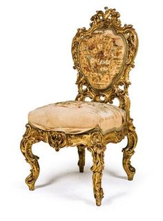 Set of four Neo-Rococo chairs, presumably the original furniture from Linderhof Palace, designed and produced by the workshops of Anton Pössenbacher circa 1873. Serpentine and richly carved lindenwood chairs with flowers and rocaille, painted gold. Height ca. 118 cm. The chairs are upholstered, one with original covers, which are brittle and have some holes. Wien, Dorotheum, 22.04.15, no. 588.