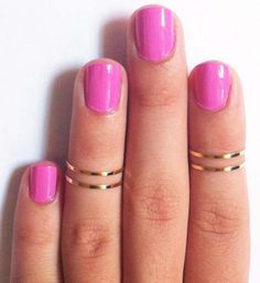Knuckle rings and pink nails