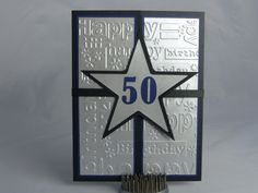 Included is one handmade happy 50th birthday card. This gate fold card features a black base that was layered with blue cardstock and silver,
