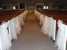 Both sides of the pews were draped with twinkle lights and white tulle. Lovely look.