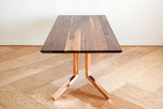 traditionally joined solid hardwood tabletop with a beveled edge detail on welded metal legs | Monroe Workshop