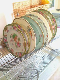 delabelle: I bought a set of miss matched vintage china yesterday to replace my chipped Ikea plates.  My favorites are the ones in the foreground and in the very back, they are part of a Royal Daulton set dating from 1904.