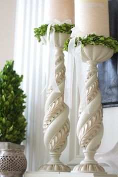 boxwood candle rings around pillar candles. too cute!