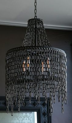 Dark design for this Victoria in chains chandelier made with steel and blackened nickel chain. @idlights