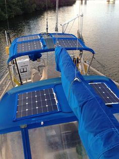 Flexible solar panels on bimini. Not sure if flexible is more economical, but they are light and, well, flexible!