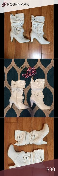 White High Heel Boots Comfy fabric inside boot with adjustable side straps. Side zipper that makes it easy to slide foot in shoe. Never worn no scratches or scuffs. Shoes Heeled Boots