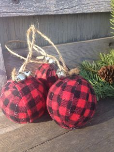 Buffalo Plaid adds a festive touch to your Christmas tree and holiday decorating. Youll receive 3 ornaments as pictured, with a twine hangar, silver jingle bells and secured with a pearl head pin. Ornaments look great hanging on the tree or remove the hangar and mix in with greenery displays or in a bowl with other balls, such as my rustic burlap. Photos are stock photos, all props are used to give you decorating ideas, you will receive 3 plaid ornaments.