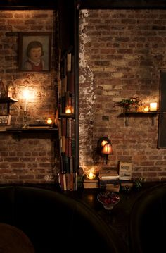 Really lovely light and brick effect .interiordecline: The now closed Allen and Delancy by my favorite designer, Jason Volenec Brick In The Wall, Brick And Stone, Brick Interior, Interior And Exterior, Beautiful Candles, Beautiful Space, Exposed Brick Walls, Candle Lanterns, Vintage Roses