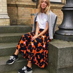 30 Perfect Looks To Copy This September #refinery29 http://www.refinery29.com/2016/09/121868/new-outfit-ideas-september-2016#slide-4 Forget the over-the-shoulder jacket or cardigan. This season, it's all about the over-the-shoulder sweatshirt.Marimekko skirt, New Balance shoes....