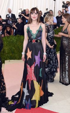 Out of this world: Dakota Johnson dazzled at the Met Gala in New York in a colourful star gown on Monday night