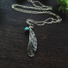 Sterling silver dragonfly wing necklaces with turquoise bead £32.00  lovely delicate piece; and I cant imagine how tricky it must be to make a cast from an actual dragonfly wing