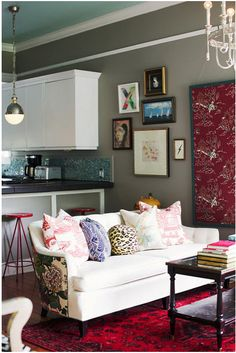 If the back of sofa is not covered by a console, why not cover it in a statement fabric?