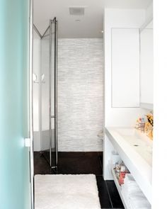 PHOTO: JOHNNY MILLER  <5 of 20 >  Under-the-Sink Shelving  Living's Kevin Sharkey gave his bathroom a complete renovation. Our favorite organizing element is the undersink shelf for sleek storage.  Tour the Rest of the Home