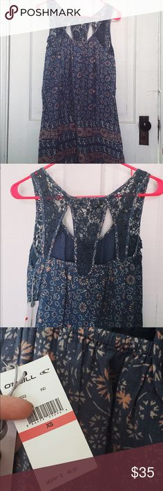 O'Neill Floral and Lace Swimsuit Coverup Dress NWT O'Neill bathing suit cover/dress. Never worn. 100% cotton, super soft. Floral pattern with lace straps and back design. Cotton lining. O'Neill Dresses