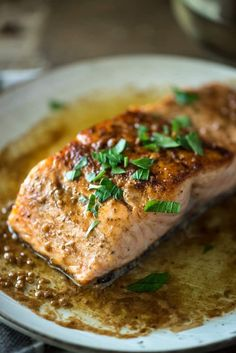 This Pan Seared Salmon with Lemon White Wine Butter Sauce is a fast and easy salmon recipe for busy weeknights. Only six ingredients and 20 minutes!