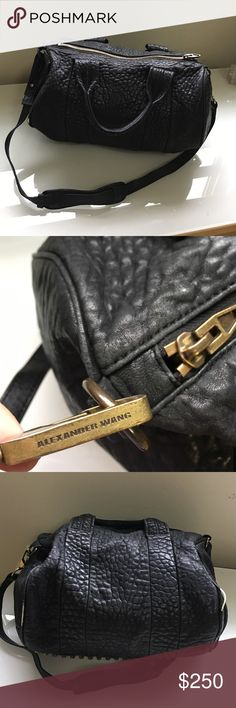 "🔥 Alexander Wang ""Rocco"" pebbled leather bag 🔥 💯% AUTHENTIC Alexander Wang ""Rocco"" black pebbled leather(lamb) duffel bag/satchel with antique brass hardware. This is a gorgeous bag. It does show signs of wear especially along the pipping. As you can see from the photos some of it has come through the leather - this is common in these bags. It can be repaired at a leather repair shop. Please feel free to ask questions. Thanks! 💓 Alexander Wang Bags Shoulder Bags"