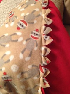 Fleece blanket with bow edges.