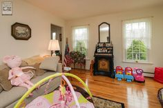 We installed lovely new windows in this pretty living room with toys for the kids...  Home remodeling / home improvement / renovations / replacement windows from Renewal by Andersen Long Island